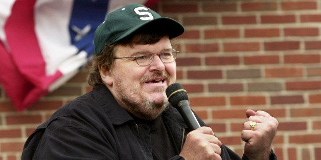 BOSTON - JULY 27:  Filmmaker Michael Moore addresses a crowd of people who couldn't get inside a packed 'Take America Back' c