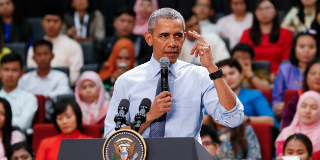 U.S. President Barack Obama gestures as he speaks at the Young Southeast Asian Leaders Initiative (YSEALI) during a town hall