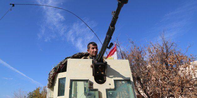 MOSUL, IRAQ - NOVEMBER 20: Peshmerga forces belonging to the Kurdish Regional Government (KRG) in armored vehicle patrol the