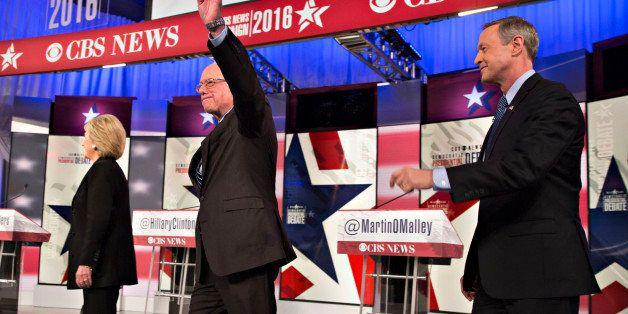 Democratic presidential candidates Hillary Clinton, former Secretary of State, left, Senator Bernie Sanders, an independent f