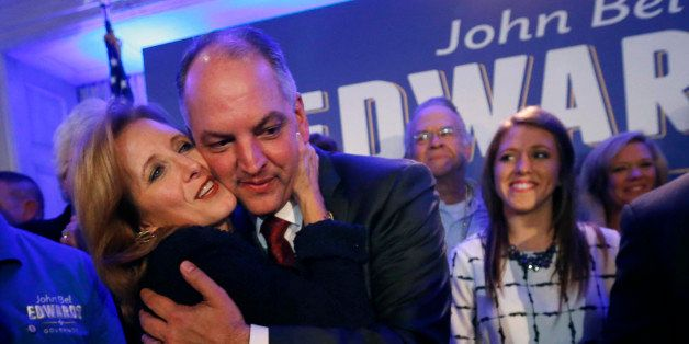 Louisiana Gov.-elect John Bel Edwards hugs his wife Donna Edwards as he arrives to greet supporters at his election night wat