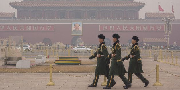 BEIJING, CHINA - 2015/01/16: Guard soldiers walk on Tiananmen square in the heavy haze.  This is the first Yellow warning of