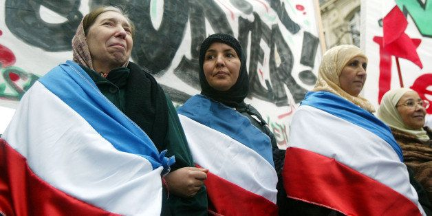 PARIS - JANUARY 17:  Muslim women demonstrate against the French proposal to bar Muslim women from wearing headscarves in sta