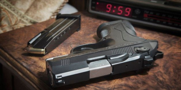Berreta 9mm PX4 Storm semi-automatic pistol on bedside nightstand