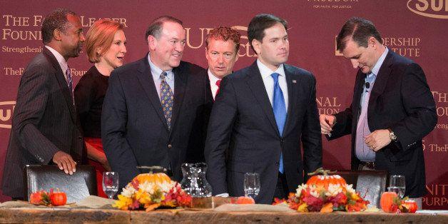 DES MOINES, IA - NOVEMBER 20:  Republican presidential candidates (LtoR) Ben Carson, Carly Fiorina, Mike Huckabee, Sen. Rand