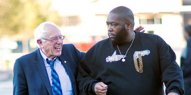 Democratic presidential candidate Sen. Bernie Sanders, I-Vt. left, walks in with rapper Killer Mike for a visit to The Busy B