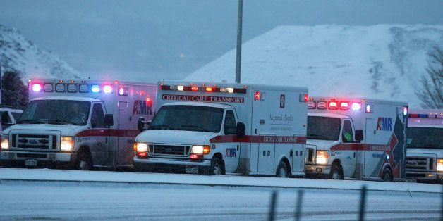 Ambulances wait to be directed near intersection of Centennial and Fillmore near a Planned Parenthood clinic Friday, Nov. 27,