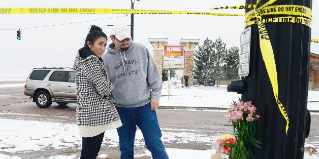 COLORADO SPRINGS, CO - NOVEMBER 28: Justina Apodaca and Dylan Watson look a the memorial after laying flowers on the corner o