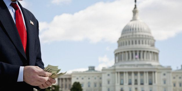 A politician counting money in front of the US Capitol Building