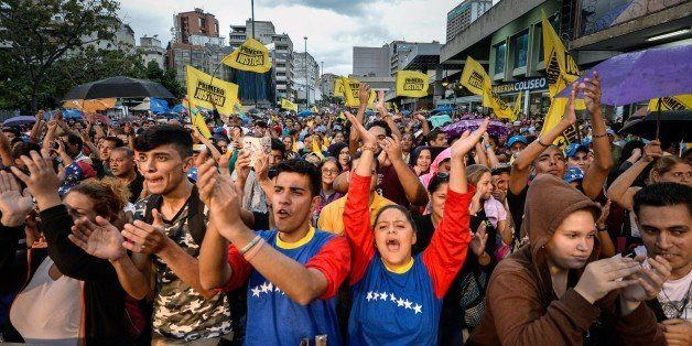 Supporters cheer during a Movement of Democratic Unity (MUD) opposition party's rally, in Caracas on December 2 , 2015. Sixte