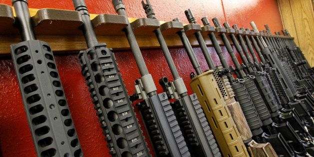 FILE - In this July 20, 2012, file photo, a row of different AR-15 style rifles are displayed for sale at the Firing-Line ind
