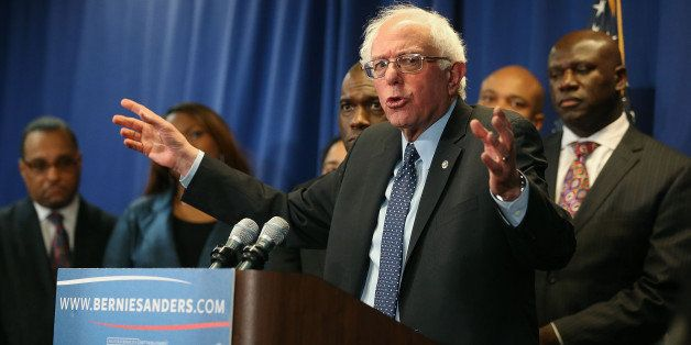 BALTIMORE, MD - DECEMBER 08:  Democratic presidential candidate Sen. Bernie Sanders, (I-VT) speaks while flanked by African-A