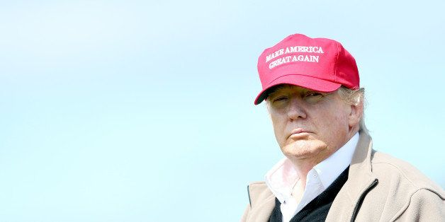 Presidential contender Donald Trump looks on at the 16th green on the 1st first day of the Women's British Open golf champion