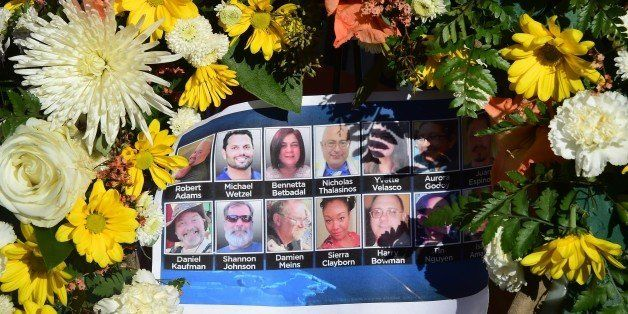 The deceased are remembered with their pictures on a sheet placed within a wreath at a makeshift shrine near the scene of the