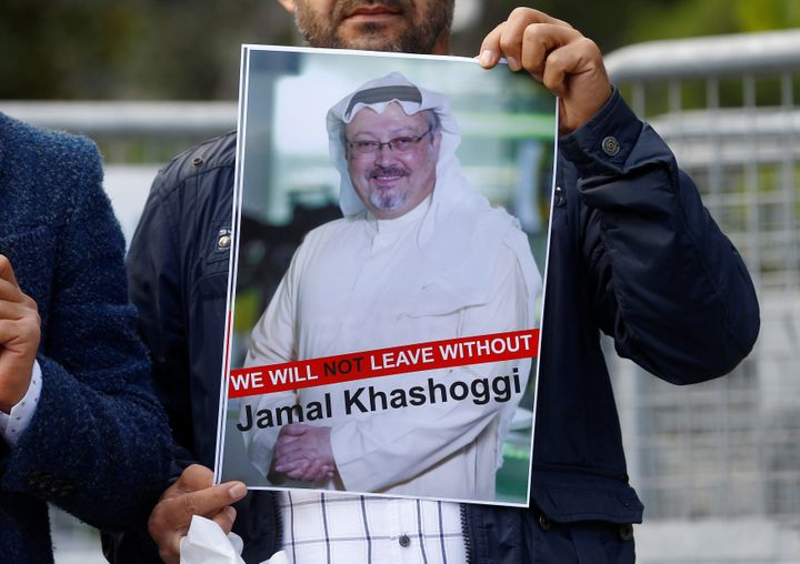 A demonstrator holds picture of Saudi journalist Jamal Khashoggi during a protest in front of Saudi Arabia's consulate in Ist