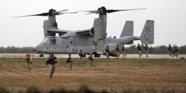 A V-22 Osprey and marines perform a demonstration during the visit of US Secretary of Defense and Spanish Defence Minister to