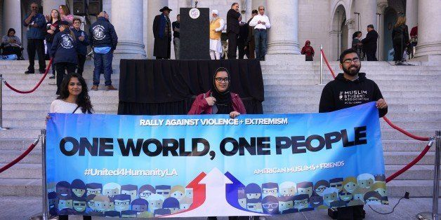 LOS ANGELES, UNITED STATES - DECEMBER 13: Protesters hold a banner written 'One world, one people' on it as hundreds of Calif