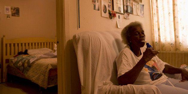 Elderly woman in Port Arthur takes breathing treatments.