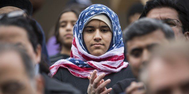 STERLING, VA - DECEMBER 11:  Hidayah Martinez Jaka, a young Venture Scout, wearing an American flag hijab is seen as U.S. Dem
