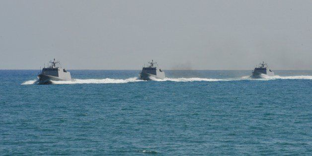 Three Taiwanese-built missile boats take part in an exercise in waters off the southern naval base of Tsoying on July 21, 201