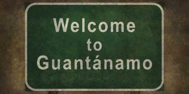 Welcome to Guantanamo road sign illustration with distressed ominous background.