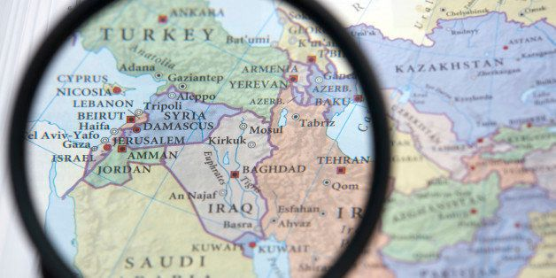 Syria and the Middle East on a map seen through a magnifying glass