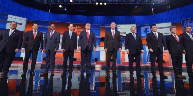 Republican presidential candidates arrive on stage for the Republican presidential debate on August 6, 2015 at the Quicken Lo