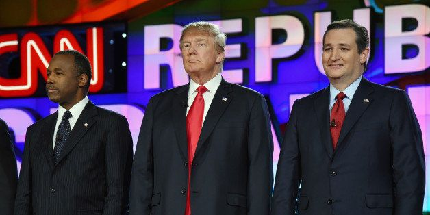 LAS VEGAS, NV - DECEMBER 15:  Republican presidential candidates (L-R) Ben Carson, Donald Trump and Sen. Ted Cruz stand on st
