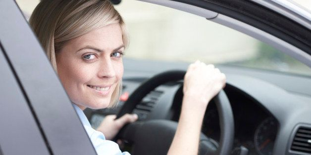 portrait of woman driving a car