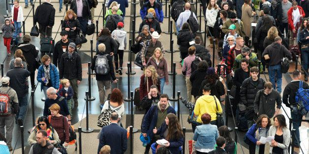 DENVER, CO - NOVEMBER 26: Security lines at  Denver International Airport are long but moving fast, November 26, 2014. The ai