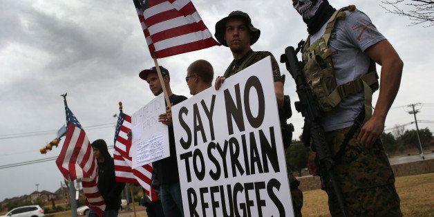 RICHARDSON, TX - DECEMBER 12: Armed protesters from the so-called Bureau of American-Islamic Relations (BAIR), take part in a