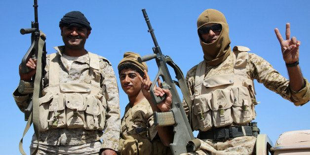 Armed Yemeni tribesmen from the Popular Resistance Committees, supporting forces loyal to Yemen's Saudi-backed President Abed