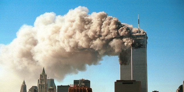 NEW YORK - SEPTEMBER 11, 2001:  (SEPTEMBER 11 RETROSPECTIVE) Smoke pours from the twin towers of the World Trade Center after