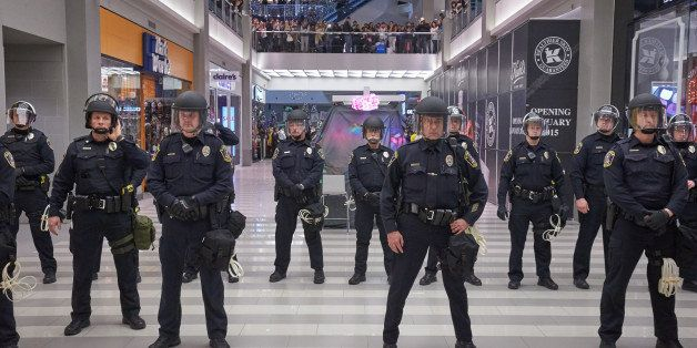 BLOOMINGTON, MN - DECEMBER 20: Police move thousands of protesters from the group 'Black Lives Matter' out of the mall after