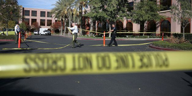 SAN BERNARDINO, CA - DECEMBER 07:  Officials put up police tape in front of the builiding at the Inland Regional Center were
