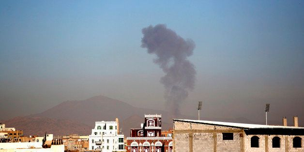 Smoke rises after a Saudi-led airstrike hits an army base in Sanaa, Yemen, Saturday, Dec. 5, 2015. (AP Photo/Hani Mohammed)