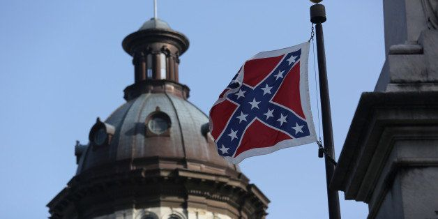 COLUMBIA, SC - JULY 09: The Confederate flag flies in front of the South Carolina statehouse for the last full day on July 9,