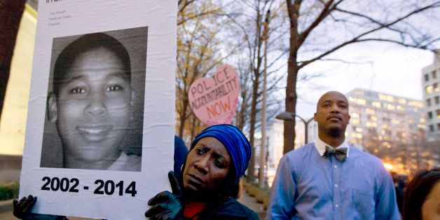 FILE - In a Monday, Dec. 1, 2014 file photo, Tomiko Shine holds up a picture of Tamir Rice, the 12 year old boy fatally shot