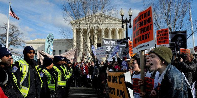 WASHINGTON, DC - JAN 22: There were heated exchanges between (R) pro-choice (pictured) rally goers and anti-abortion protesto