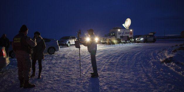 Media gather outside  the entrance of the Malheur Wildlife Refuge Headquarters near Burns, Oregon, January 3, 2016, where an