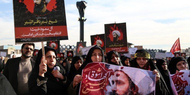 TEHRAN, IRAN - JANUARY 4: Demonstrators hold posters of Nimr Baqir al-Nimr during a protest rally against the execution of pr