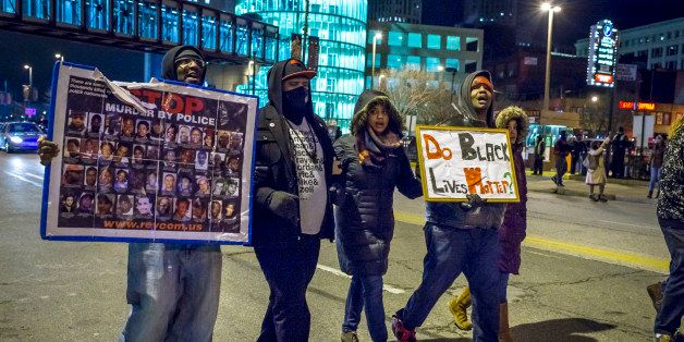 CLEVELAND, OH - DECEMBER 29: Protestores march on Huron Road on December 29, 2015 in Cleveland, Ohio. Demonstrators took to t