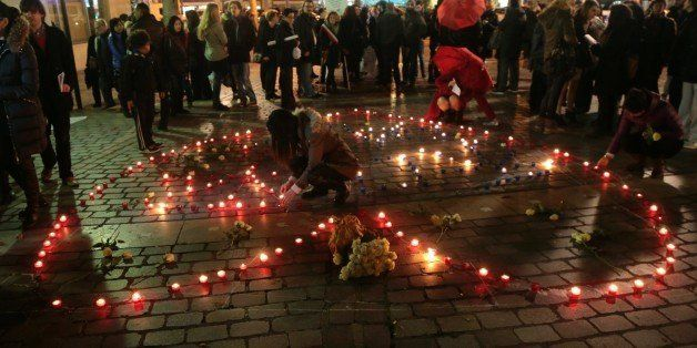 People set candles to form the word 'Peace' and in a heart shape during a demonstration to support sex workers rights on Dece
