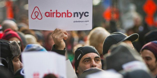 Supporters of Airbnb hold a rally outside City Hall, Tuesday, Jan. 20, 2015, in New York. With home-as-hotel sites like Airbn