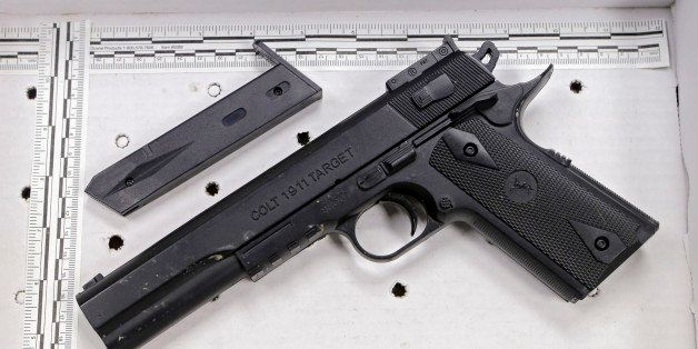 FILE- In a Wednesday, Nov. 26, 2014 file photo, a fake handgun taken from 12-year-old Tamir Rice, who was fatally shot by Cle