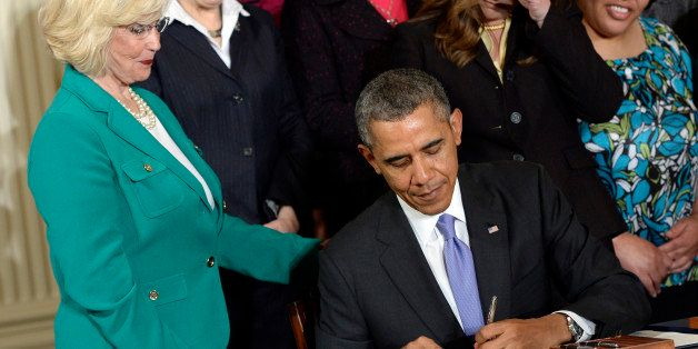 President Barack Obama signs executive actions, with pending Senate legislation, aimed at closing a compensation gendergap