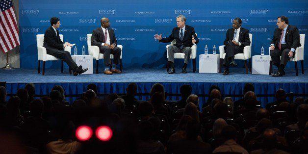 Republican presidential candidates Jeb Bush, center,  Ben Carson and New Jersey Gov. Chris Christie, right, participate in an