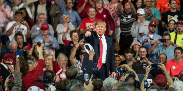 AIKEN, SC - DECEMBER 12:  Republican presidential candidate Donald Trump points to the crowd at a town hall meeting December