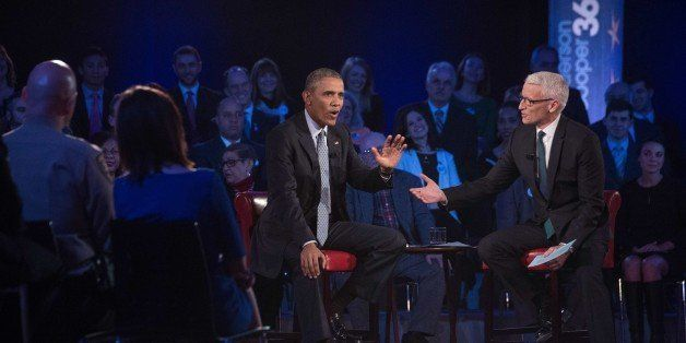 US President Barack Obama speaks at a town hall meeting with CNN's Anderson Cooper (R) on reducing gun violence at George Mas