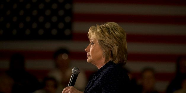 Democratic presidential candidate Hillary Clinton pauses for a moment while speaking at a rally Monday, Jan. 11, 2016, in Wat